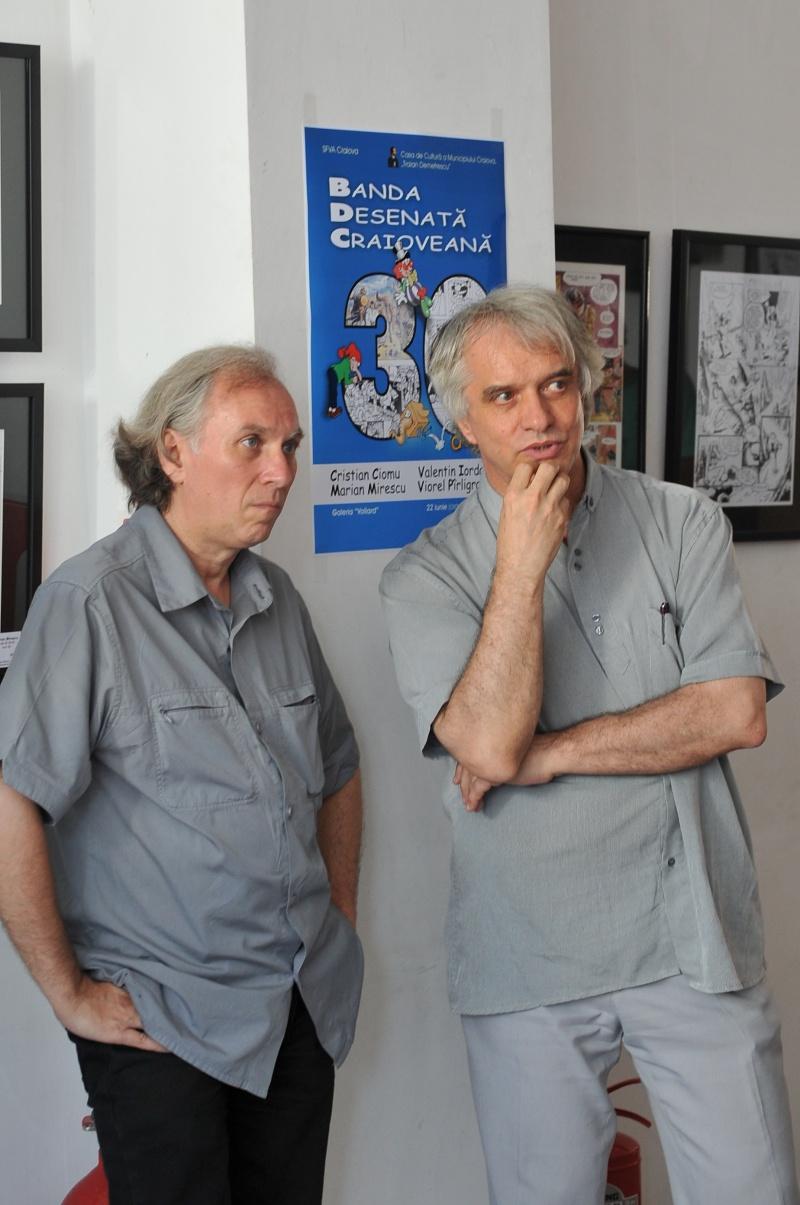 Viorel şi Cristi, reflectând la pasiunea de a face bandă desenată